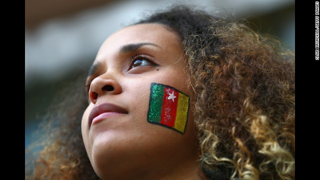 A fan sports a Cameroon flag painted on her face during the match against Brazil.