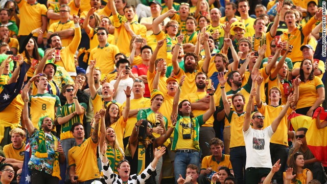 Australian fans cheer during the match against Spain at Arena da Baixada.