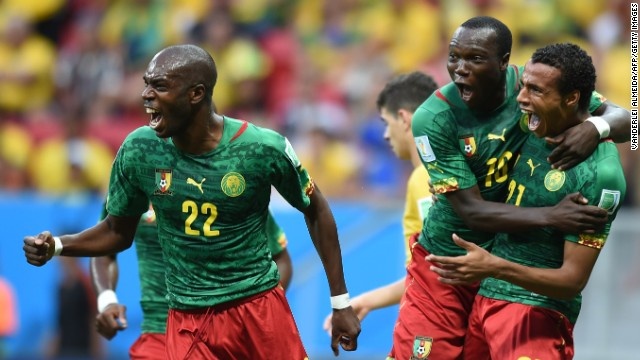 Cameroon midfielder Joel Matip, right, celebrates with Allan Nyom and Vincent Aboubakar after scoring a goal against Brazil.
