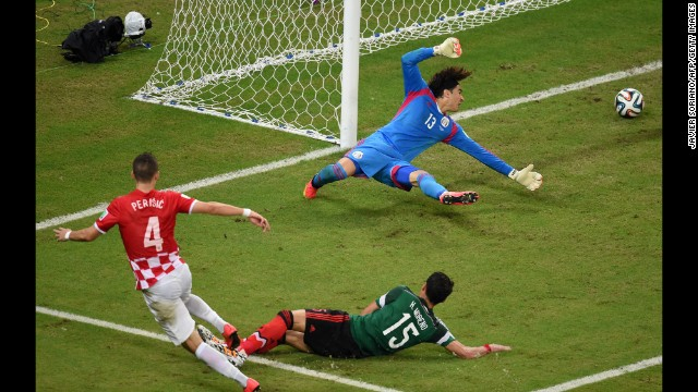 Goalkeeper Guillermo Ochoa of Mexico fails to stop Croatian midfielder Ivan Perisic from scoring on Monday, June 23, in Recife, Brazil. Mexico won 3-1.