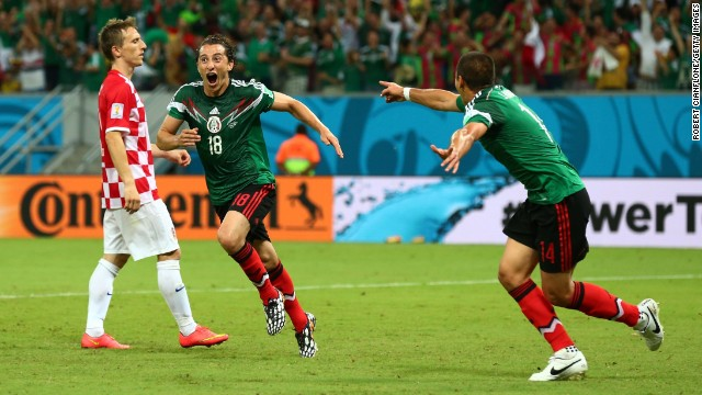 Andres Guardado of Mexico, center, celebrates after scoring the second goal against Croatia.