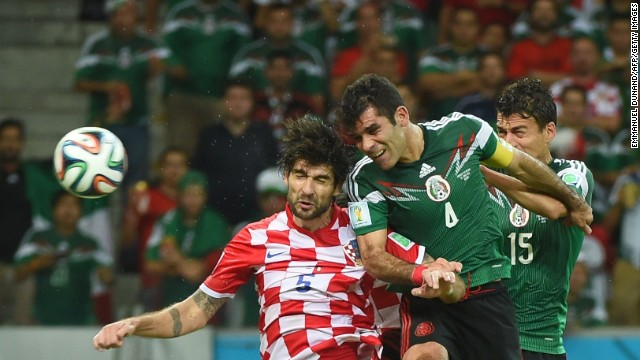 Mexico's Rafael Marquez, center, heads the ball to score his team's first goal against Croatia.