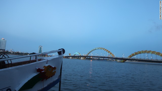 Boat tours make the most of the bridge's popularity -- prows are painted with the dragon's likeness.