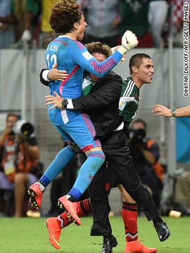 "Herrera celebrates one of Mexico's goals against Croatia with goalkeeper Guillermo Ochoa. He later told a press conference Monday was ""one of the happiest days of his life."""