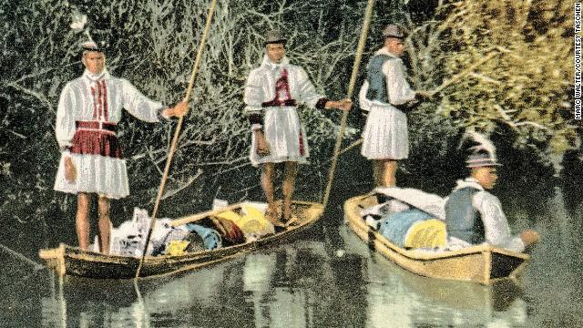 Seminole Indian family in dugout canoe, Miami River, Florida.