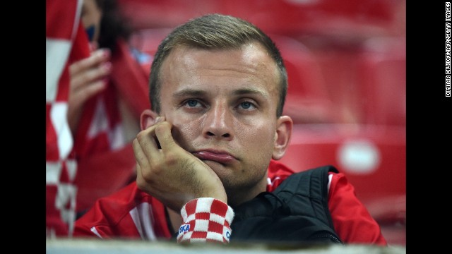 A Croatia supporter reacts after his team lost to Mexico on Monday, June 23.