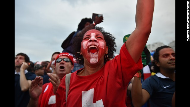 Switzerland supporters cheer while watching their team play against France on Friday, June 20. France won the match 5-2.