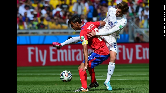 England midfielder Adam Lallana, right, vies for the ball against Costa Rica forward Bryan Ruiz.