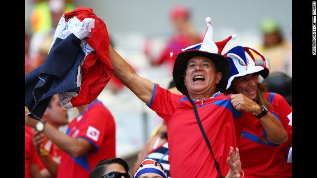 A Costa Rica fan enjoys the atmosphere prior to the match against England. See the best World Cup photos from June 23.