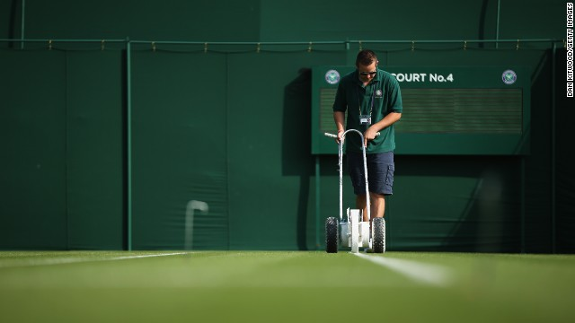 The grass courts are prepared prior to the matches on day two of the championships.