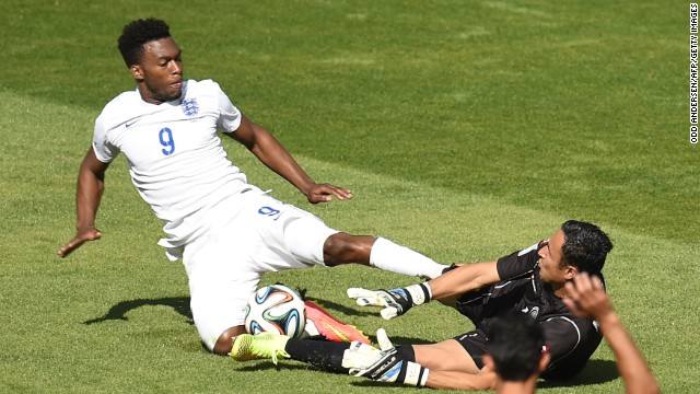 England forward Daniel Sturridge, left, challenges Costa Rica goalkeeper Keylor Navas.