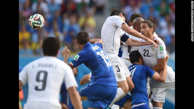 Uruguay's Diego Godin, second right, scores against Italy on June 24 in Natal, Brazil. Uruguay won 1-0.