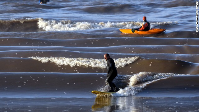 The Severn Bore in Gloucestershire, UK, is created when rising tides in the Bristol Channel force water up the Severn Estuary, creating waves of up to 2.8 meters. One surfer once rode the wave for five miles.