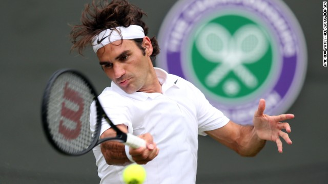Roger Federer opened up his 2014 campaign with a straight-sets (6-1 6-1 6-3) victory over Italy's Paolo Lorenzi.