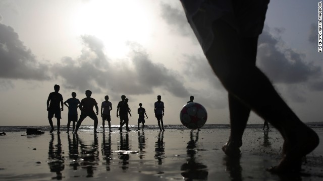 "JUNE 24 - MUMBAI, INDIA: Indian youths play football on the coast of the Arabian Sea in Mumbai, India. Although India has not qualified for the <a href='http://cnn.com/2014/06/12/sport/football/world-cup-schedule-of-matches/index.html'>FIFA World Cup</a>, which is running at the moment,<a href='http://cnn.com/2013/04/25/sport/football/indian-football-manchester-united/'> FIFA president Sepp Blatter once described Indian football as a ""sleeping giant.""</a>"
