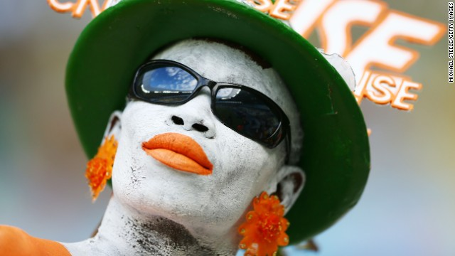 An Ivory Coast fan enjoys the atmosphere prior to kickoff.
