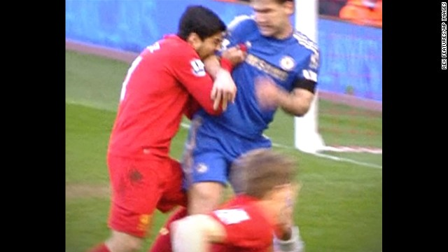 Suarez, left, was banned for 10 games in April 2013 after being found guilty of biting Chelsea defender Branislav Ivanovic during a English Premier League soccer match.