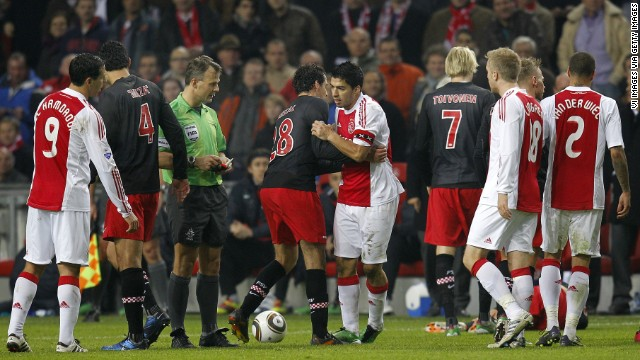 During his time in the Netherlands with Ajax in 2011, Suarez was banned for seven games after leaving a scar on the collarbone of Amsterdam player Otman Bakkal.