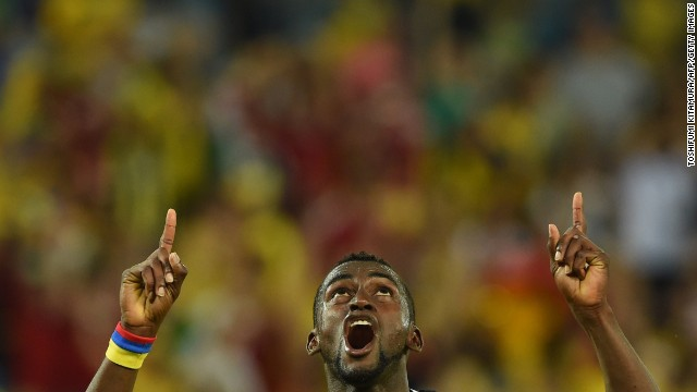 Colombia's Jackson Martinez celebrates after scoring his second goal against Japan.