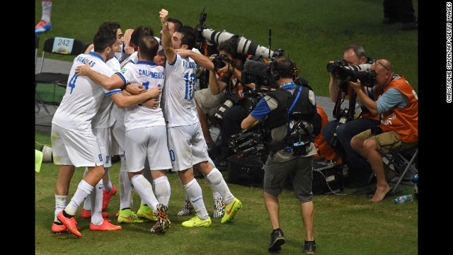 Greece's players celebrates scoring against the Ivory Coast.