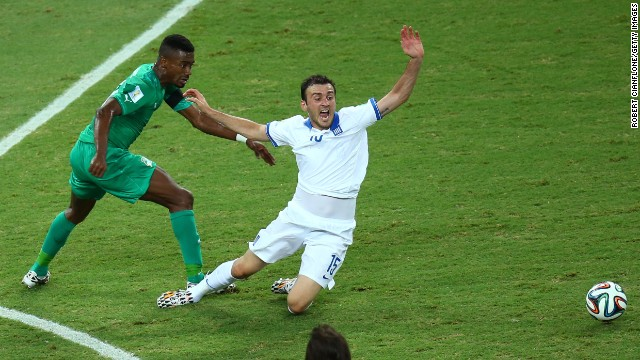 Salomon Kalou of the Ivory Coast challenges Vasilis Torosidis of Greece.