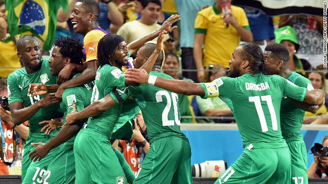 Ivory Coast's Wilfried Bony, second from left, celebrates with teammates after scoring a goal against Greece.