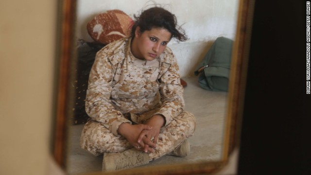Female Peshmerga between 18 and 45 years old form a special unit that is called to serve in any conditions. A soldier is pictured here on June 25.
