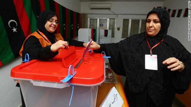 A Libyan woman casts her vote at a polling station in the capital of Tripoli on June 25, 2014.