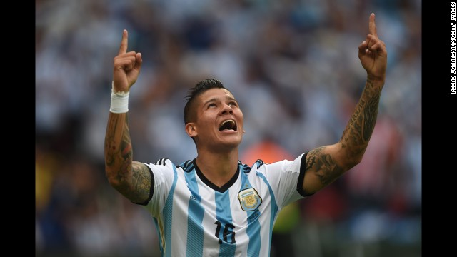 Argentina defender Marcos Rojo celebrates his team's third goal against Nigeria in Porto Alegre, Brazil, on June 25. Argen