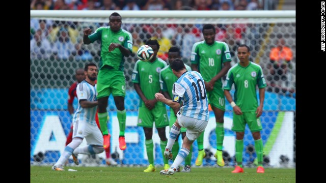 Argentina forward Lionel Messi scores his team's second goal against Nigeria.