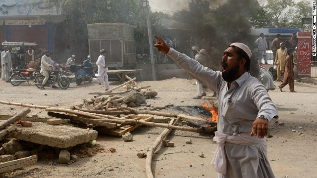 A displaced Pakistani civilian protests against the food shortage. Many expressed anger anger at the long delays.