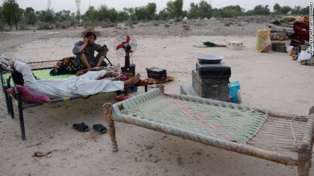 Displaced Pakistani civilians rest on their arrival in Bannu on June 24. The Pakistani Army launched an offensive on militants near their homes in North Waziristan, forcing many to seek safety.