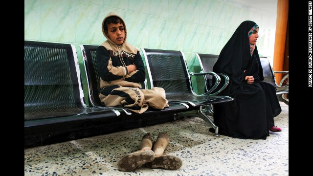 Sajad Faleh, 12, waits for his assessment at the rehabilitation center in Najaf. He lost both his legs to a land mine in 2006. He also lost two of his brothers in the blast.