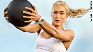 Do a chopping motion with a medicine ball to whittle your waistline.