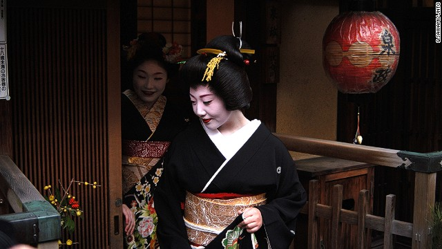 """Geisha are aware they are special ... and subject to interest, but people need to respect them,"" says Avi Lugasi, who runs a travel company in Kyoto. He helps clients get photos such as this one of an apprentice geisha leaving a tea house in Gion district."