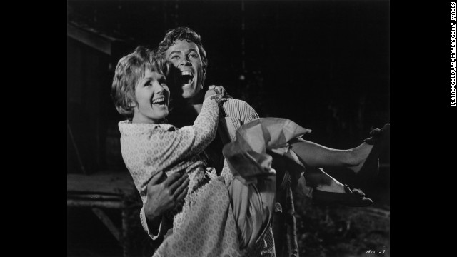 """The musical """"The Unsinkable Molly Brown,"""" starring Debbie Reynolds and Harve Presnell, was among the most popular movies in the summer of 1964. Reynolds was nominated for an Academy Award, but lost to Julie Andrews."""