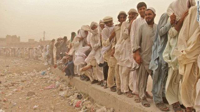 Displaced Pakistani residents queued to receive rations of fortified wheat, iodized salt, pulses and cooking oil.