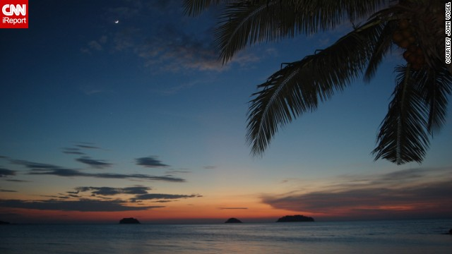 The sun sets over the Andaman Sea off the coast of <a href='http://ireport.cnn.com/docs/DOC-1145792'>Phuket, Thailand</a>, in July 2013, as seen in this photo by John Vogel.