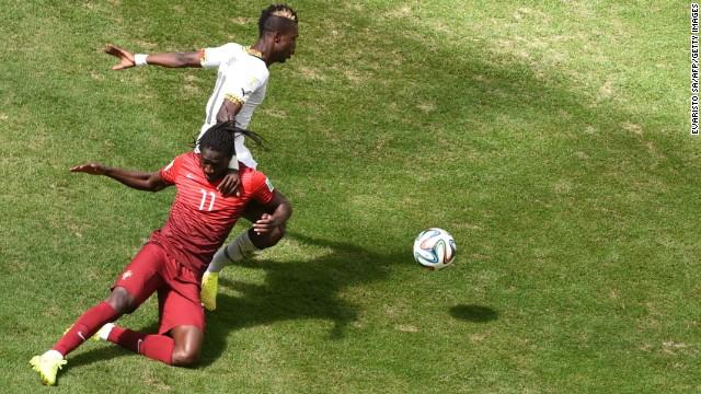 Portugal's Eder, left, and Ghana's John Boye vie for the ball.