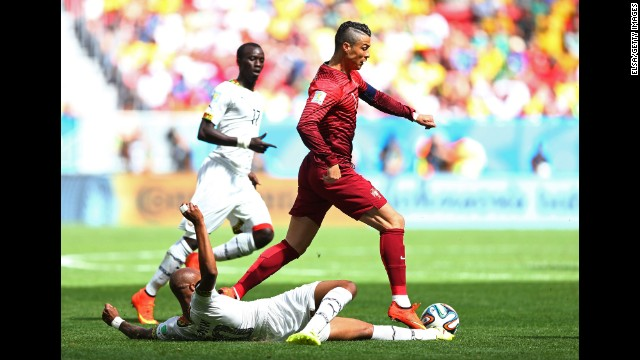Andre Ayew of Ghana tackles Cristiano Ronaldo of Portugal.