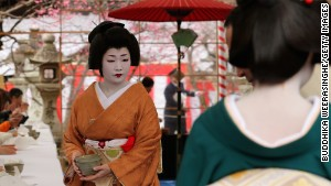 A geisha serves tea during Kyoto\'s annual Plum Blossom Festival.
