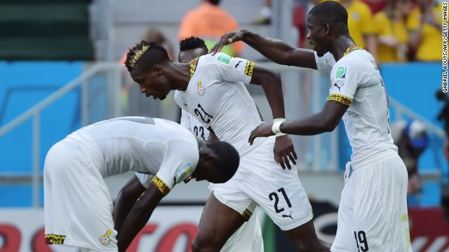 Ghana defender John Boye, center, reacts after making an own goal against Portugal.