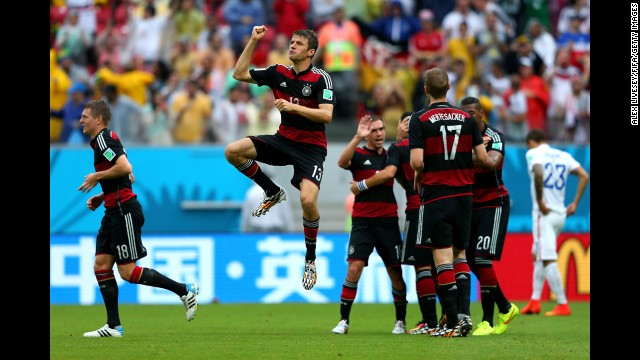 Thomas Mueller leaps in celebration after scoring what would be the only goal in Germany's victory over the United States.