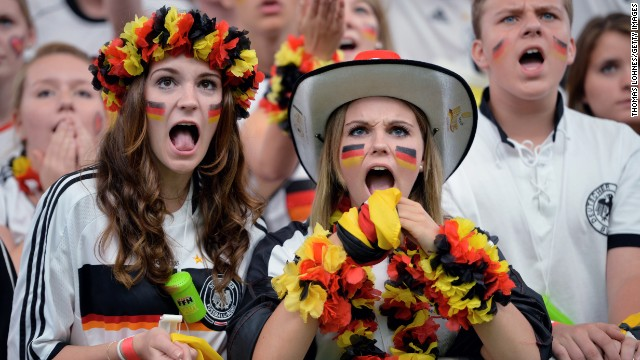 Two young fans of Germany watch the match against the United States.