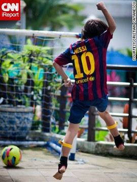 "Score! Cristian Catanescu's 9-year-old son celebrates after <a href='http://ireport.cnn.com/docs/DOC-1143310'>getting a goal</a> on his family's terrace in Singapore. ""Football brings joy to this boy! He changed places and continents several times and his best way to connect to local people is through football,"" said Catanescu."