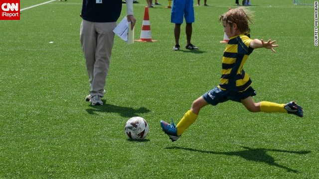 """William Hyndman<a href='http://ireport.cnn.com/docs/DOC-1142690'> flies through the air</a> as he approaches the ball at a tournament in Phuket, Thailand. """"William currently plays on a soccer team with teammates from Singapore, England, Japan, Australia, Romania, Canada and India,"""" said his mom, Tracy. """"Our mutual passion for soccer has brought this unlikely group together."""""""