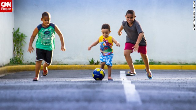 "Whether you call it soccer or football, this game is beloved around the world. In the Dominican Republic, Misael Rincon's kids and their cousin ""have <a href='http://ireport.cnn.com/docs/DOC-1144246'>World Cup fever</a>!"" Here, they race for the ball outside Rincon's Santo Domingo home. ""My kids love the baseball but for a few days here [they] have replaced the bat and glove for a football,"" he said. Click through the gallery to see more joyful photos that illustrate the world's love affair with soccer."