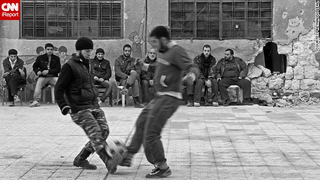 A group of Free Syrian Army fighters in Aleppo, Syria, takes a break for a <a href='http://ireport.cnn.com/docs/DOC-1143212'>quick game of pick-up soccer</a>. Photographer Reynaldo Leal captured the game while documenting the conflict in Syria in 2013.