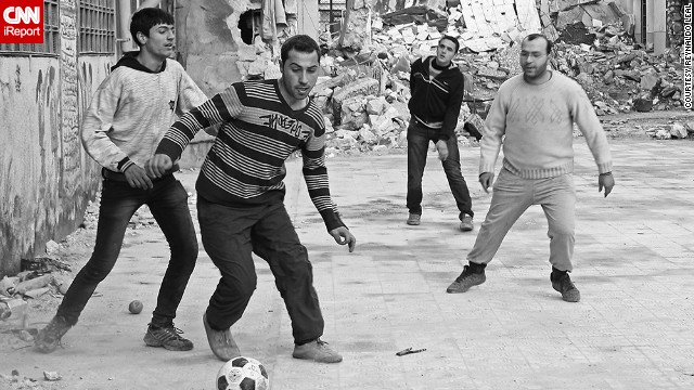 "This match took place in the courtyard of an abandoned elementary school in Syria, said Leal. ""Everything had been so serious on the front lines that day, so I was surprised to find the fighters playing a pick-up game of football,"" he said."