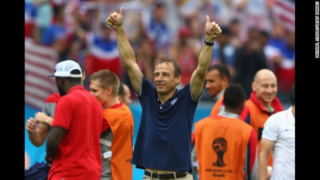 Head coach Jurgen Klinsmann of the United States acknowledges the fans after his team's 1-0 loss to Germany in Recife, Brazil. Despite the loss, the U.S. team advances to the round of 16 in the 2014 World Cup.